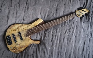 Spalted maple top    Walnut fingerboard / laminate neck       Tomasz Baran